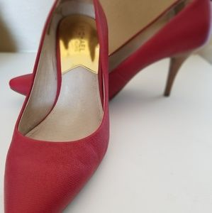 Red MK pumps